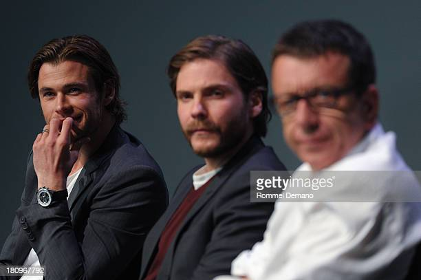 Actors Chris Hemsworth Daniel Bruhl and screenwriter Peter Morgan attend Meet The Actors at the Apple Store Soho on September 18 2013 in New York City