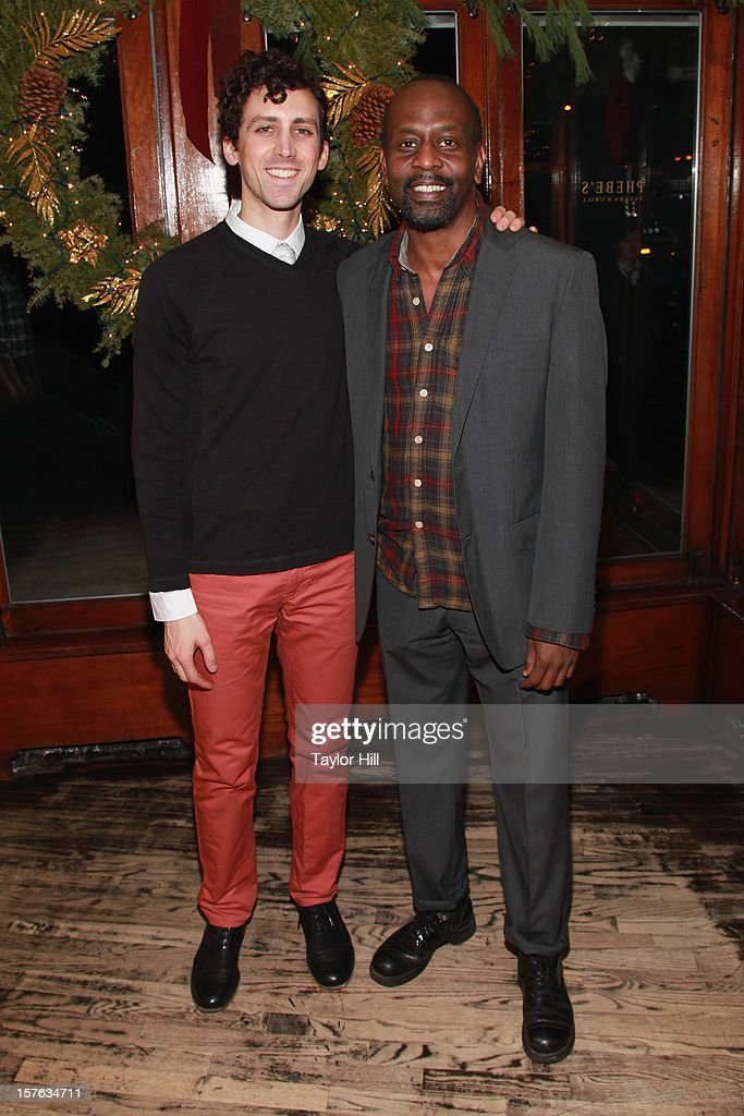 Actors Chris Henry and K. Todd Freeman attend the after party for the opening night of 'A Civil War Christmas' at Phebe's on December 4, 2012 in New York City.