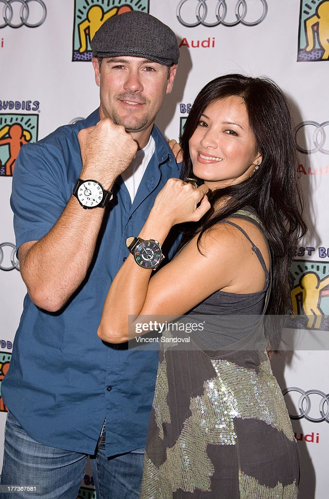 Actors Chris Jacobs and <a gi-track='captionPersonalityLinkClicked' href=/galleries/search?phrase=Kelly+Hu&family=editorial&specificpeople=202918 ng-click='$event.stopPropagation()'>Kelly Hu</a> attend the Best Buddies poker event at Audi Beverly Hills on August 22, 2013 in Beverly Hills, California.