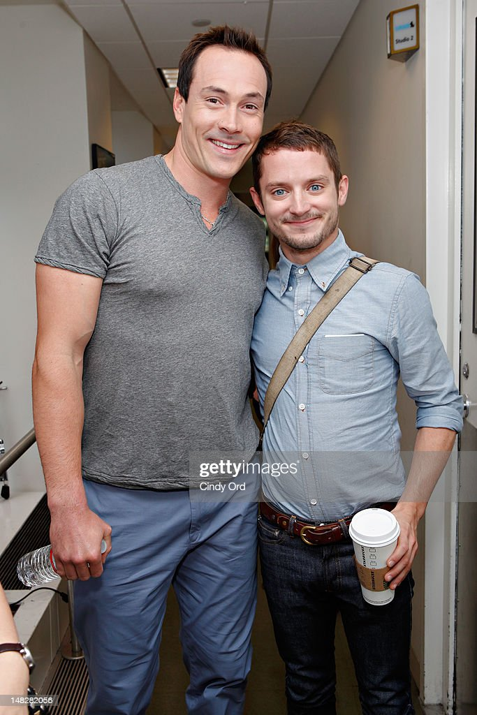 Actors Chris Klein and <a gi-track='captionPersonalityLinkClicked' href=/galleries/search?phrase=Elijah+Wood&family=editorial&specificpeople=171364 ng-click='$event.stopPropagation()'>Elijah Wood</a> visit the SiriusXM Studio on July 10, 2012 in New York City.