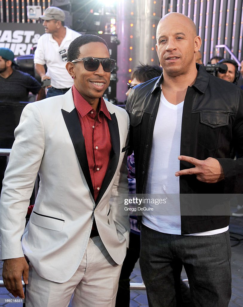 Actors Chris 'Ludacris' Bridges and Vin Diesel arrive at the Los Angeles premiere of 'Fast & The Furious 6' at Gibson Amphitheatre on May 21, 2013 in Universal City, California.