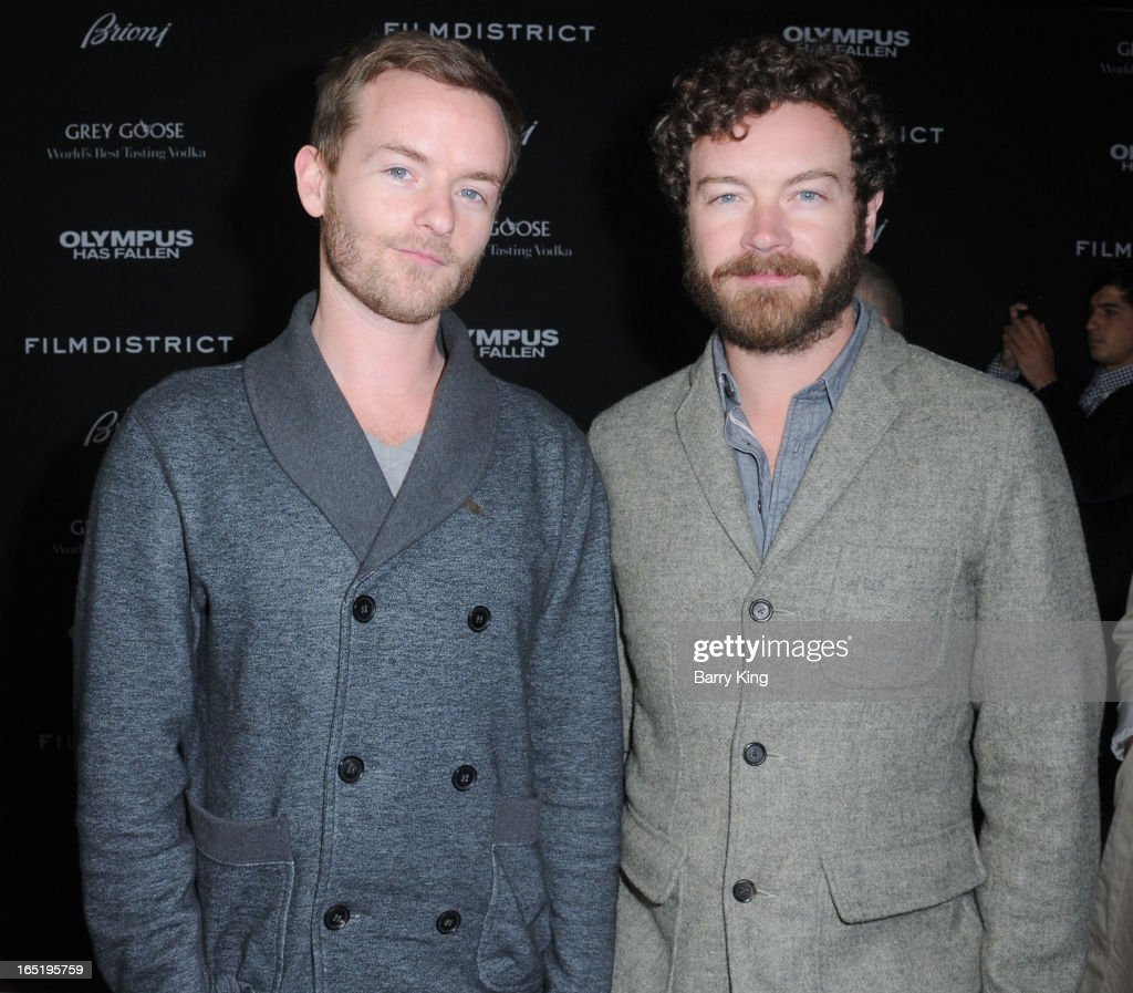 Actors Chris Masterson (L) and <a gi-track='captionPersonalityLinkClicked' href=/galleries/search?phrase=Danny+Masterson&family=editorial&specificpeople=239512 ng-click='$event.stopPropagation()'>Danny Masterson</a> arrive at the Los Angeles premiere of 'Olympus Has Fallen' held at ArcLight Cinemas Cinerama Dome on March 18, 2013 in Hollywood, California.