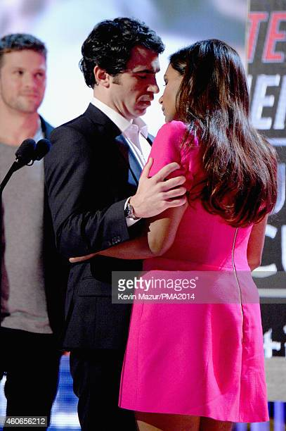 Actors Chris Messina and Mindy Kaling accept the Best Couple award onstage during the PEOPLE Magazine Awards at The Beverly Hilton Hotel on December...