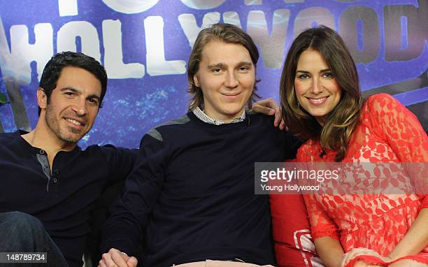 Actors Chris Messina and Paul Dano visit with host Nikki Novak at the Young Hollywood Studio on July 19 2012 in Los Angeles California