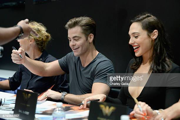 Actors Chris Pine and Gal Gadot from the 2017 feature film Wonder Woman sign autographs for fans in DC's 2016 San Diego ComicCon booth at San Diego...