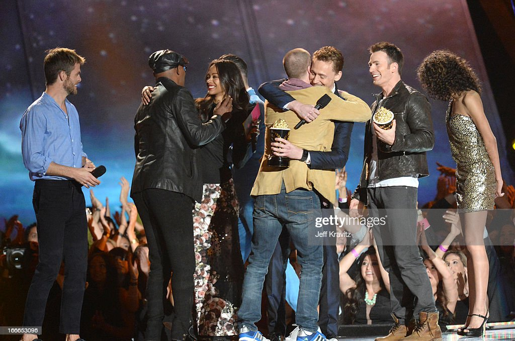 Actors Chris Pine, Samuel L. Jackson, Zoe Saldana, Zachary Quinto, director Joss Whedon actors Tom Hiddleston and Chris Evans onstage during the 2013 MTV Movie Awards at Sony Pictures Studios on April 14, 2013 in Culver City, California.