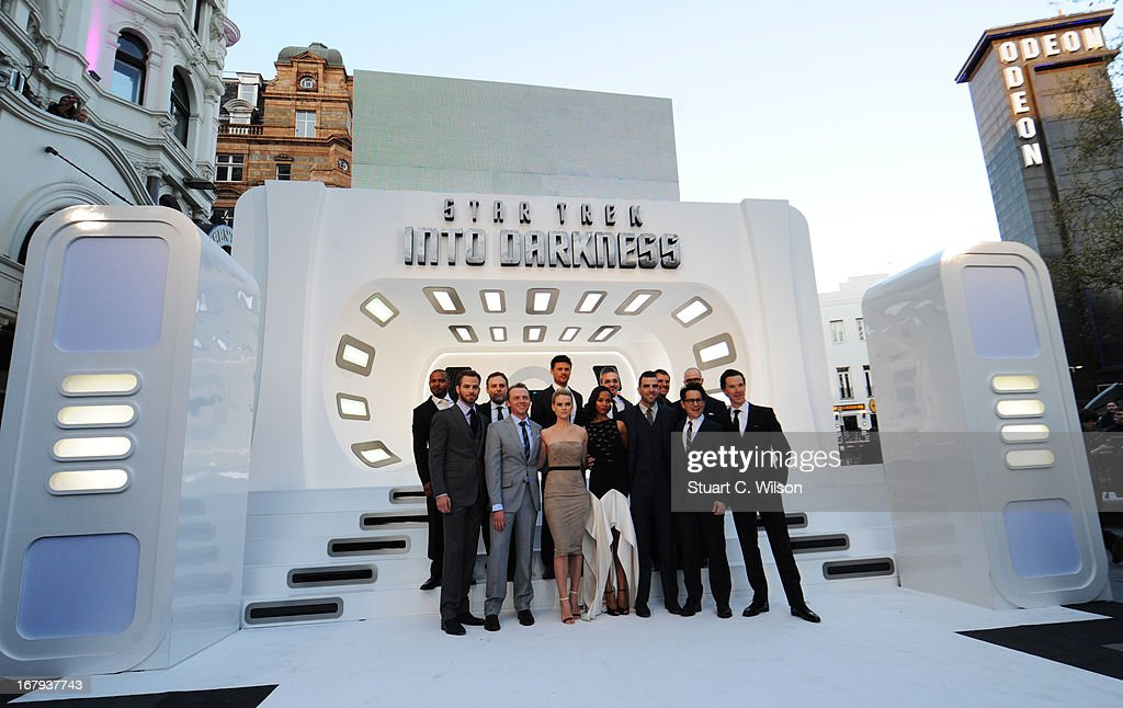 Actors Chris Pine, Simon Pegg, Alice Eve, Zoe Saldana, Zachary Quinto, Zoe Saldana, director J.J. Abrams and Benedict Cumberbatch (Back L-R) Noel Clark, producer Bryan Burk, actor Karl Urban, writer Alex Kurtzman, writer Roberto Orci and producer Damon Lindelof attend the UK Premiere of 'Star Trek Into Darkness' at The Empire Cinema on May 2, 2013 in London, England.