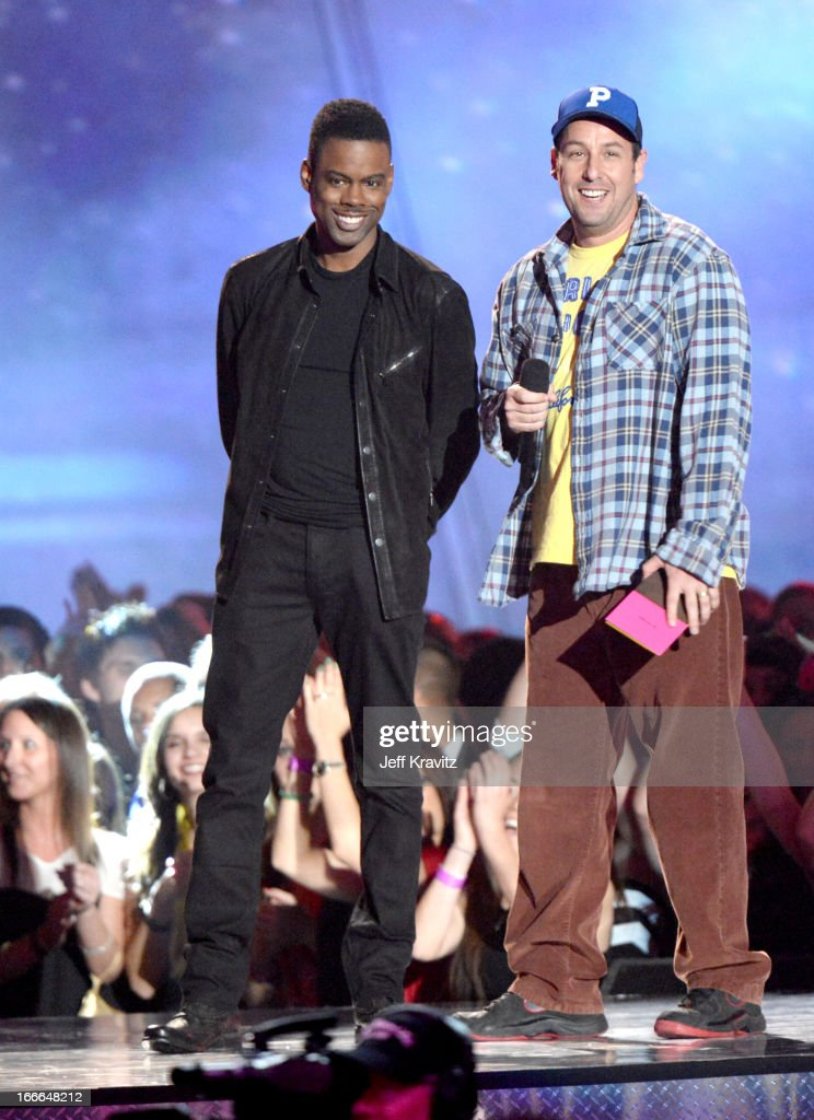 Actors Chris Rock (L) and Adam Sandler speak onstage during the 2013 MTV Movie Awards at Sony Pictures Studios on April 14, 2013 in Culver City, California.