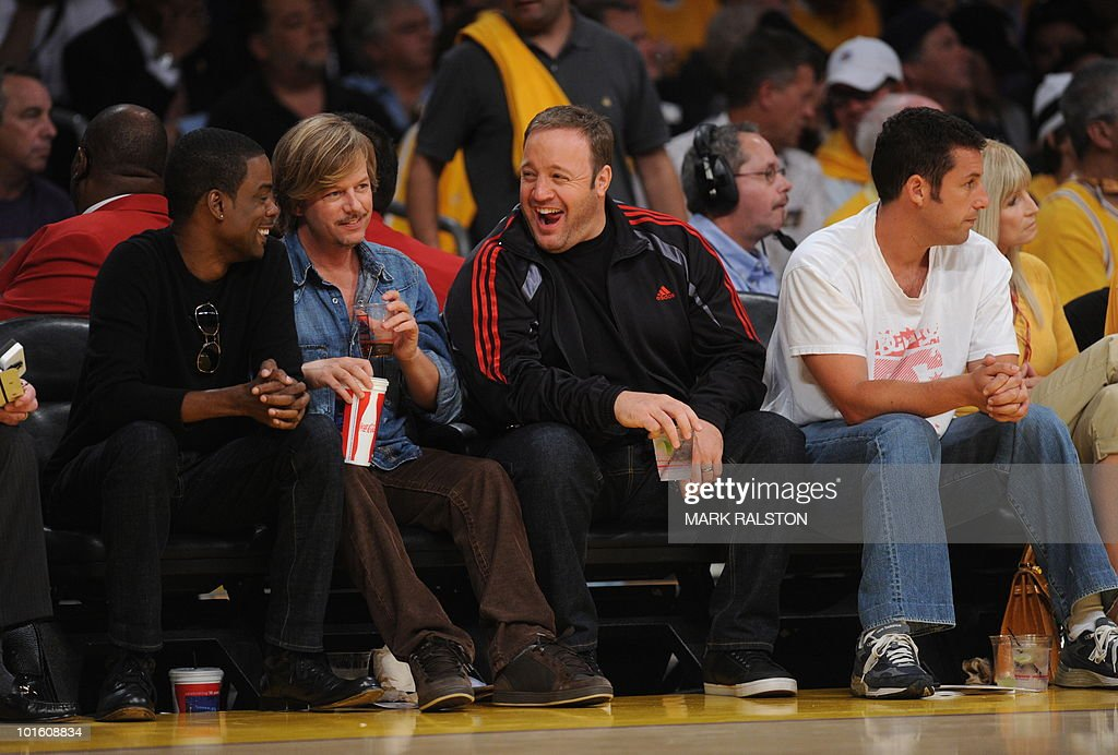 Actors (L-R) Chris Rock, David Spade, Kevin James and Adam Sandler attend during game one of the NBA finals between the Los Angeles Lakers and Boston Celtics at the Staples Center in Los Angeles on June 3, 2010. The defending champion Los Angeles Lakers are not only seeking their 16th NBA championship but also redemption after a humbling loss to the Boston Celtics in the 2008 NBA finals. The Lakers still have the bitter after taste of their humiliating finals loss two years ago. AFP PHOTO/Mark RALSTON