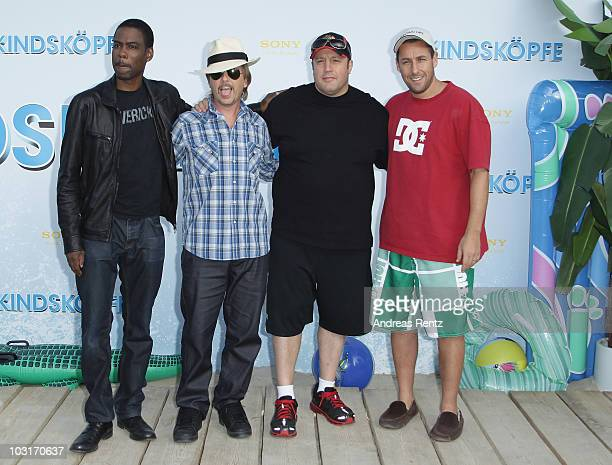 Actors Chris Rock David Spade Kevin James and Adam Sandler attend the Beach BBQ for the German Premiere of 'Kindskoepfe' at O2 World on July 30 2010...