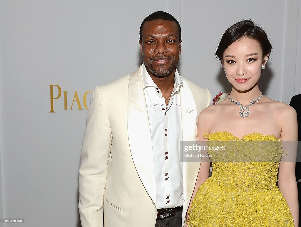 Actors <a gi-track='captionPersonalityLinkClicked' href=/galleries/search?phrase=Chris+Tucker&family=editorial&specificpeople=203254 ng-click='$event.stopPropagation()'>Chris Tucker</a> and Ni Ni pose in the Piaget Lounge during The 2013 Film Independent Spirit Awards on February 23, 2013 in Santa Monica, California.