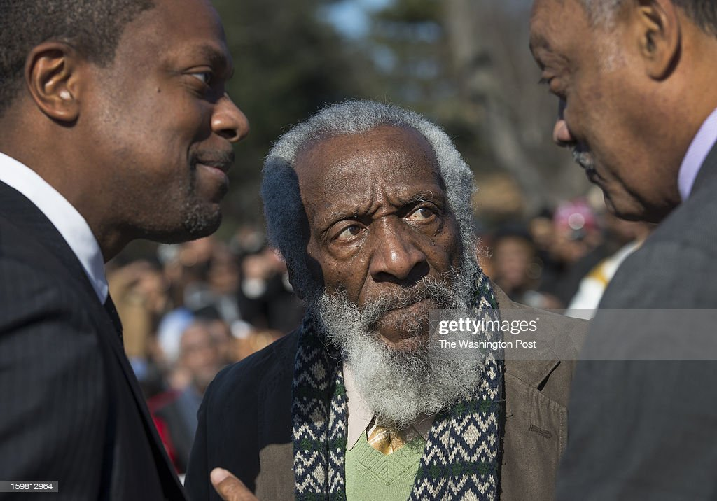 Actors Chris Tucker, Dick Gregory with Rev. Jesse Jackson at the Wreath-Laying Ceremony at the Martin Luther King Jr. Memorial in Washington, DC on January 20, 2013. It's the first wreath-laying ceremony since the Memorial was dedicated. Thousands flocked to the area today to pay tribute to the civil rights leader and his legacy. Notables at the ceremony were MLK's oldest son, Martin Luther King III, actor Jamie Foxx, The Rev. Al Sharpton, and Rev. Jesse Jackson.