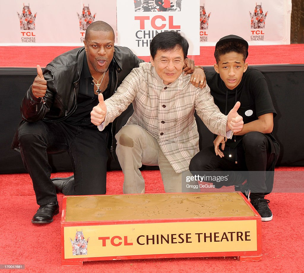 Actors Chris Tucker, Jackie Chan and Jaden Smith pose at Jackie's Hand/Footprint Cement Ceremony at TCL Chinese Theatre on June 6, 2013 in Hollywood, California.