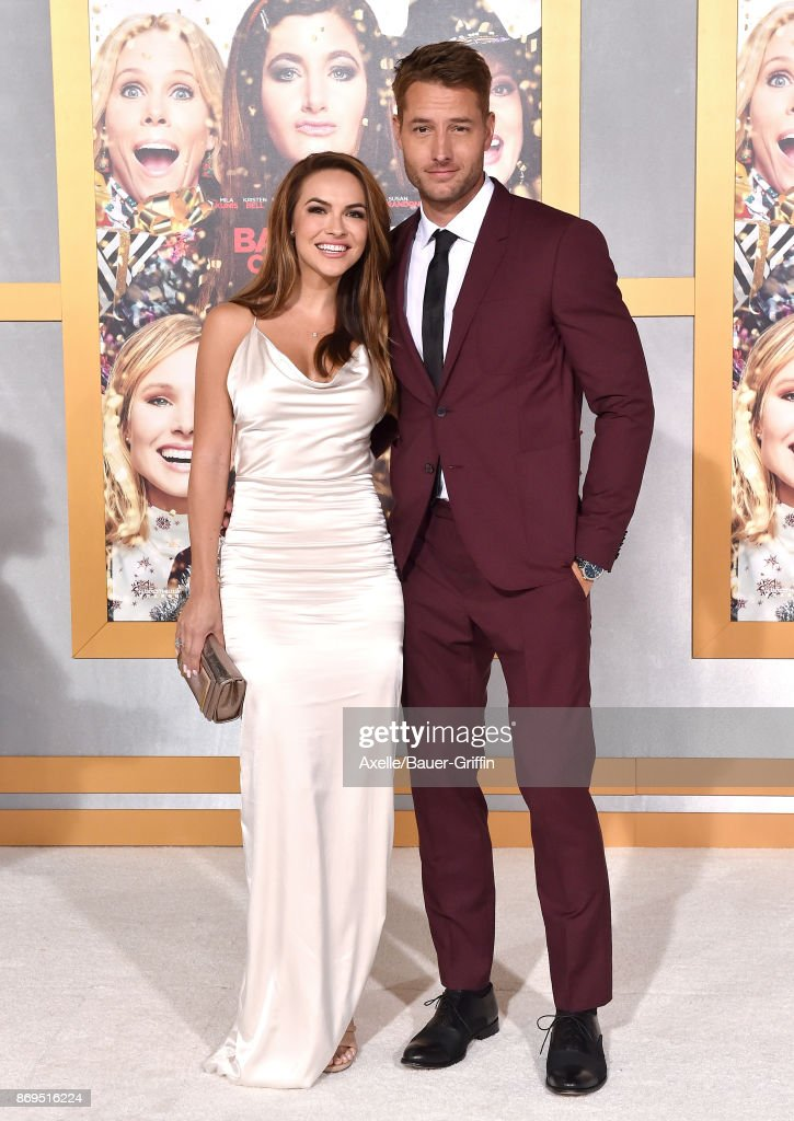 Actors Chrishell Stause and Justin Hartley arrive at the Los Angeles premiere of 'A Bad Moms Christmas' at Regency Village Theatre on October 30, 2017 in Westwood, California.
