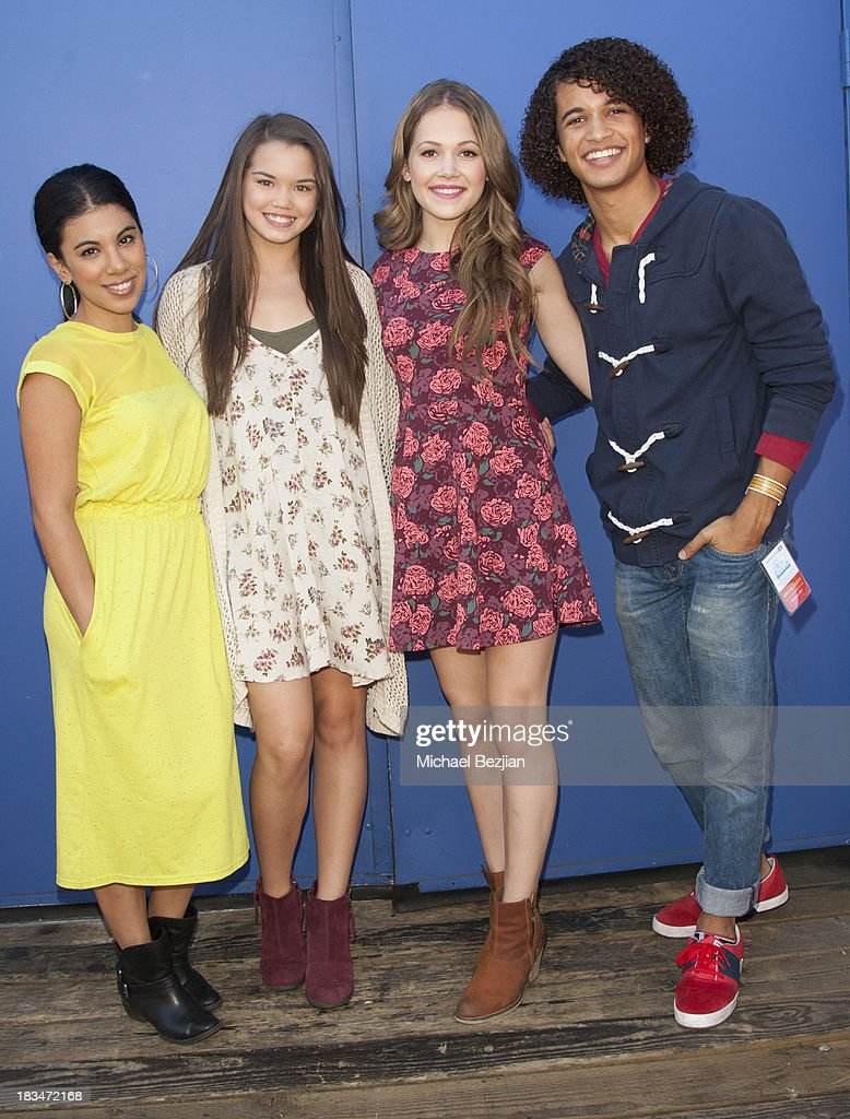 Actors <a gi-track='captionPersonalityLinkClicked' href=/galleries/search?phrase=Chrissie+Fit&family=editorial&specificpeople=8807904 ng-click='$event.stopPropagation()'>Chrissie Fit</a>, Jordan Fisher, <a gi-track='captionPersonalityLinkClicked' href=/galleries/search?phrase=Kelli+Berglund&family=editorial&specificpeople=8564069 ng-click='$event.stopPropagation()'>Kelli Berglund</a>, and Paris Berelc volunteer at the 14th Annual 'Mattel Party On The Pier' Benefiting Mattel Children's Hospital UCLA at Santa Monica Pier on October 6, 2013 in Santa Monica, California.