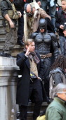 Actors Christian Bale in costume as Batman Tom Hardy as Bane and director Christopher Nolan are seen on the set of 'The Dark Knight Rises' on...