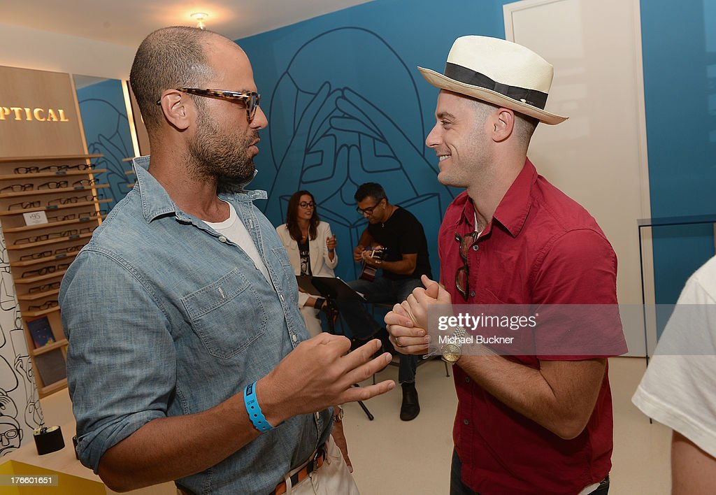 Actors Christian George (L) and Jonny Abrahams attend Warby Parker's store opening in The Standard, Hollywood on August 15, 2013 in Los Angeles, California.