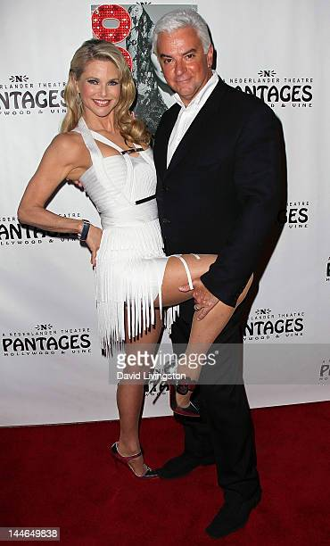 Actors Christie Brinkley and John O'Hurley pose at the opening night of 'Chicago' at the Pantages Theatre on May 16 2012 in Hollywood California