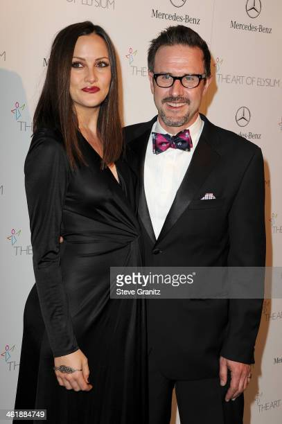 Actors Christina McLarty and David Arquette arrive at The Art of Elysium's 7th Annual HEAVEN Gala presented by MercedesBenz at Skirball Cultural...