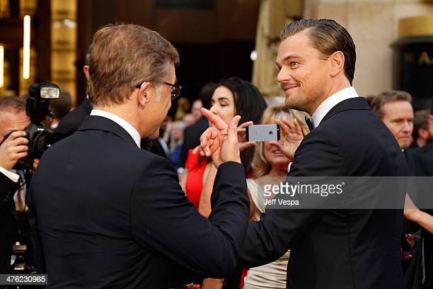 Actors Christoph Waltz and Leonardo DiCaprio attend the 86th Oscars held at Hollywood Highland Center on March 2 2014 in Hollywood California