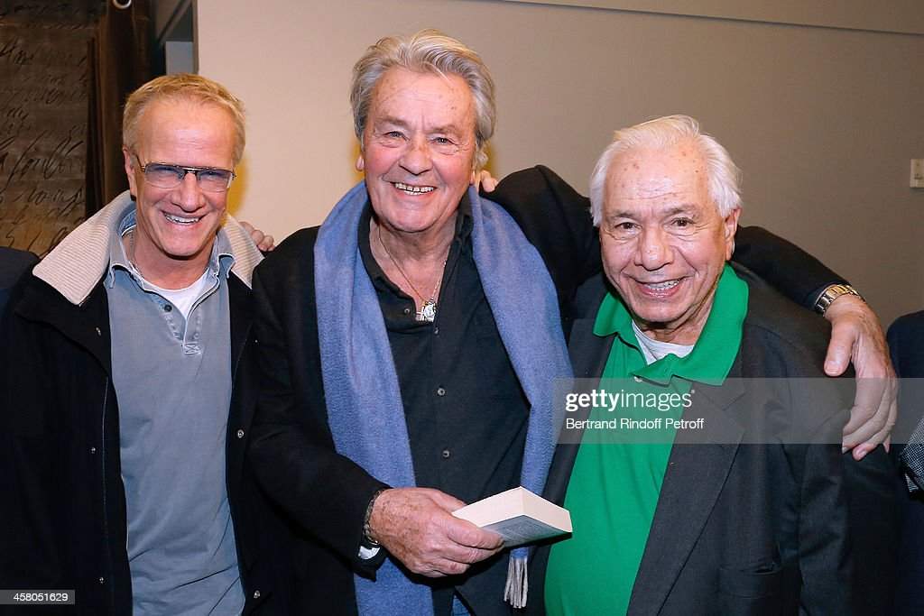 Actors Christophe Lambert, Alain Delon and Michel Galabru pose backstage following the show of impersonator Laurent Gerra 'Un spectacle Normal' at L'Olympia on December 19, 2013 in Paris, France.