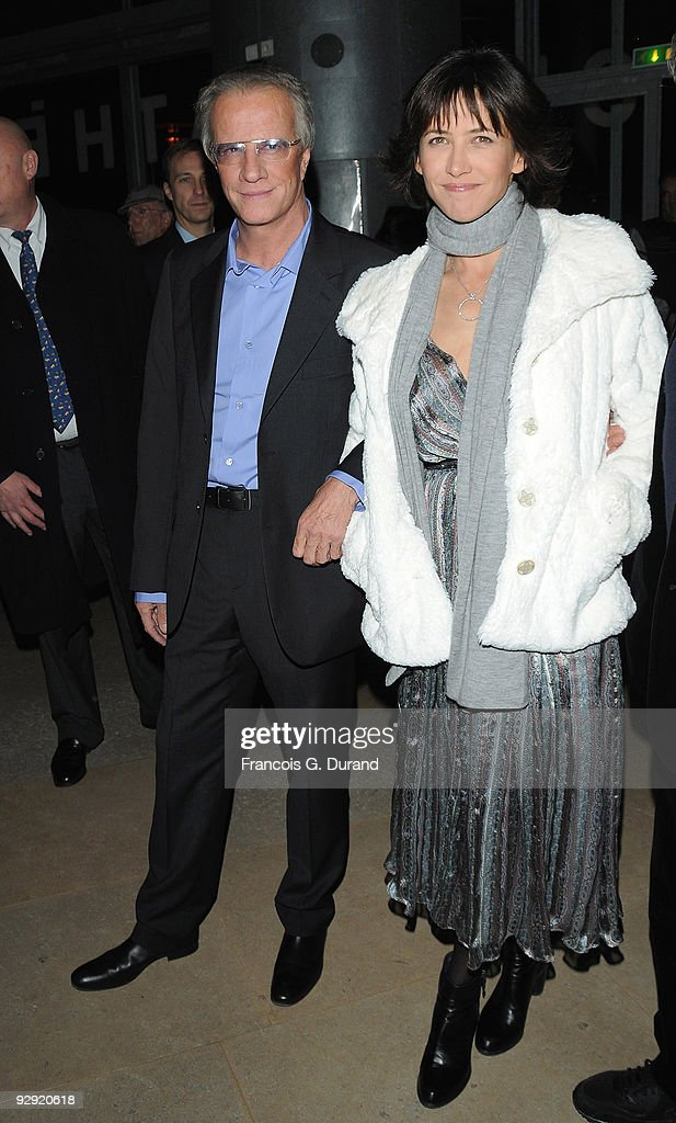 Actors Christopher Lambert (L) and his companion Sophie Marceau attend the premiere of 'L'Homme de chevet' at Cinematheque Francaise on November 9, 2009 in Paris, France.