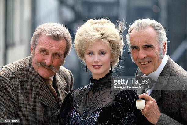 Actors Christopher Lee Morgan Fairchild and Patrick Macnee pose on a shoot for the TV movie 'Sherlock Holmes and the Leading Lady' on 1991 ca in...