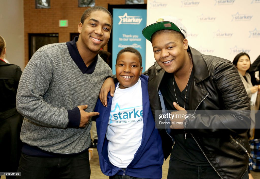 Actors Christopher Massey and Kyle Massey and patient Usaamah Edwards attend the Starkey Hearing Foundation Mission during GRAMMY Camp at University...
