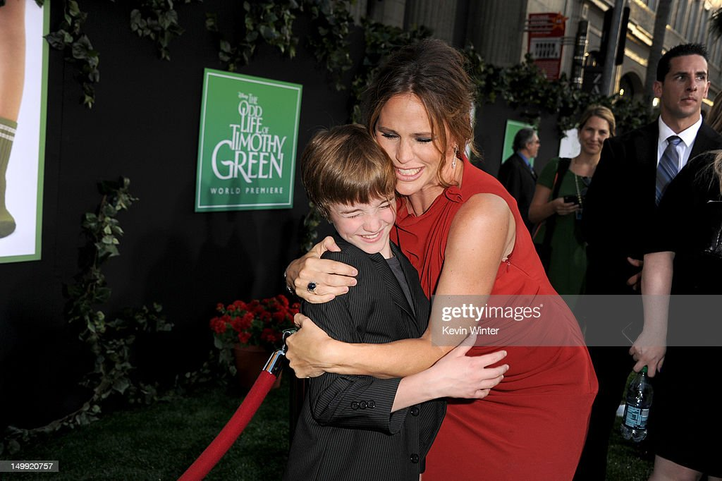 Actors CJ Adams (L) and Jeniffer Garner arrive at the premiere of Walt Disney Pictures' 'The Odd Life of Timothy Green' at the El Capitan Theatre on August 6, 2012 in Hollywood, California.