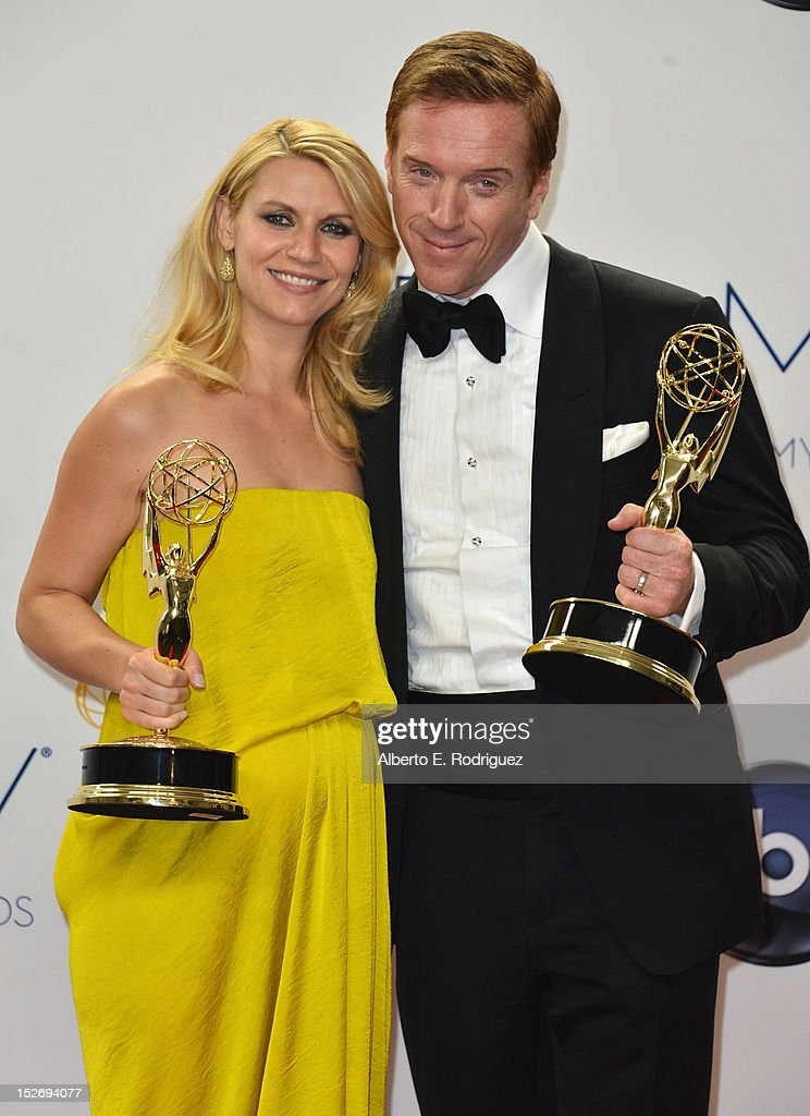 Actors <a gi-track='captionPersonalityLinkClicked' href=/galleries/search?phrase=Claire+Danes&family=editorial&specificpeople=202666 ng-click='$event.stopPropagation()'>Claire Danes</a> and <a gi-track='captionPersonalityLinkClicked' href=/galleries/search?phrase=Damian+Lewis&family=editorial&specificpeople=206939 ng-click='$event.stopPropagation()'>Damian Lewis</a> pose in the 64th Annual Emmy Awards press room at Nokia Theatre L.A. Live on September 23, 2012 in Los Angeles, California.