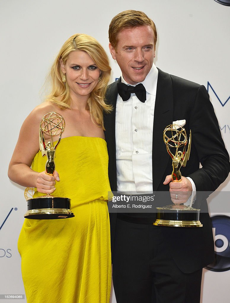 Actors Claire Danes and Damian Lewis pose in the 64th Annual Emmy Awards press room at Nokia Theatre L.A. Live on September 23, 2012 in Los Angeles, California.
