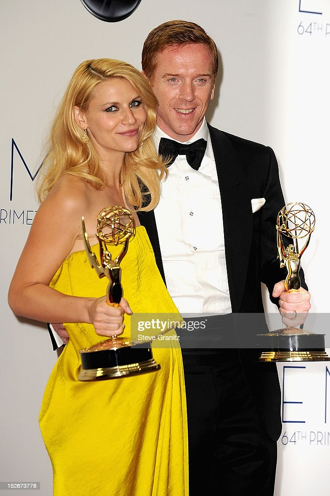 Actors Claire Danes and Damian Lewis pose in the press room of the 64th Primetime Emmy Awards at Nokia Theatre L.A. Live on September 23, 2012 in Los Angeles, California.