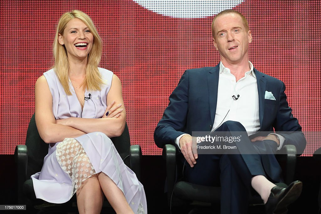 Actors <a gi-track='captionPersonalityLinkClicked' href=/galleries/search?phrase=Claire+Danes&family=editorial&specificpeople=202666 ng-click='$event.stopPropagation()'>Claire Danes</a> and <a gi-track='captionPersonalityLinkClicked' href=/galleries/search?phrase=Damian+Lewis&family=editorial&specificpeople=206939 ng-click='$event.stopPropagation()'>Damian Lewis</a> speak onstage during the 'Homeland' panel discussion at the CBS, Showtime and The CW portion of the 2013 Summer Television Critics Association tour at the Beverly Hilton Hotel on July 29, 2013 in Beverly Hills, California.