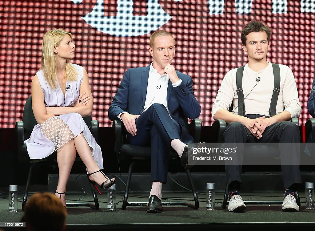 Actors Claire Danes, Damian Lewis and Rupert Friend speak onstage during the 'Homeland' panel discussion at the CBS, Showtime and The CW portion of the 2013 Summer Television Critics Association tour at the Beverly Hilton Hotel on July 29, 2013 in Beverly Hills, California.