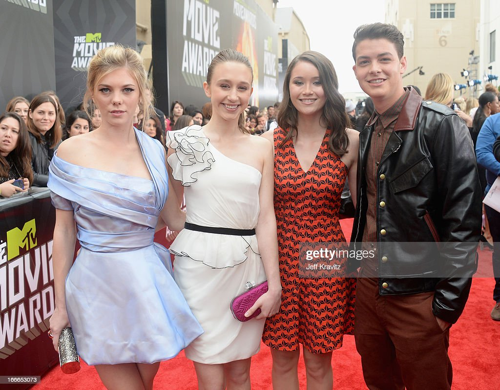 Actors Claire Julien, Taissa Farmiga, Katie Chang, and Israel Broussard attend the 2013 MTV Movie Awards at Sony Pictures Studios on April 14, 2013 in Culver City, California.