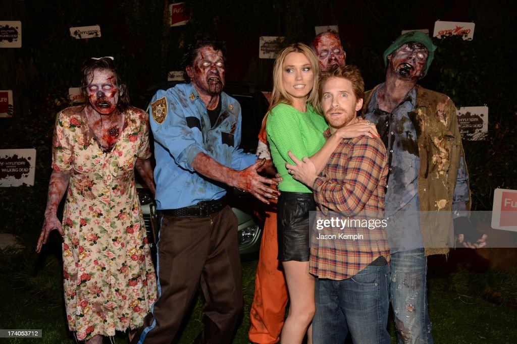 Actors <a gi-track='captionPersonalityLinkClicked' href=/galleries/search?phrase=Clare+Grant&family=editorial&specificpeople=4122159 ng-click='$event.stopPropagation()'>Clare Grant</a> (third from left) and <a gi-track='captionPersonalityLinkClicked' href=/galleries/search?phrase=Seth+Green&family=editorial&specificpeople=206390 ng-click='$event.stopPropagation()'>Seth Green</a> (second from right) attend 'The Walking Dead' 10th Anniversary Celebration Event during Comic-Con 2013 on July 19, 2013 in San Diego, California.