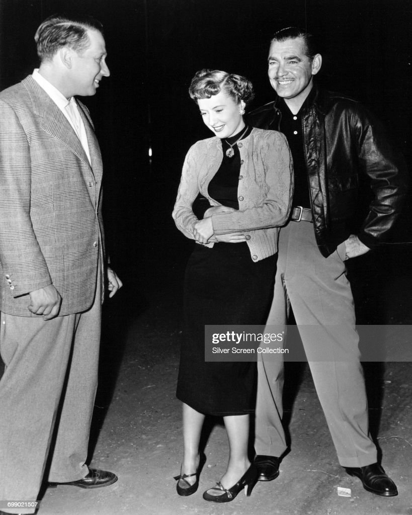 Actors Clark Gable (right) and Barbara Stanwyck enjoying a laugh on the set of the film 'To Please a Lady', 1950.