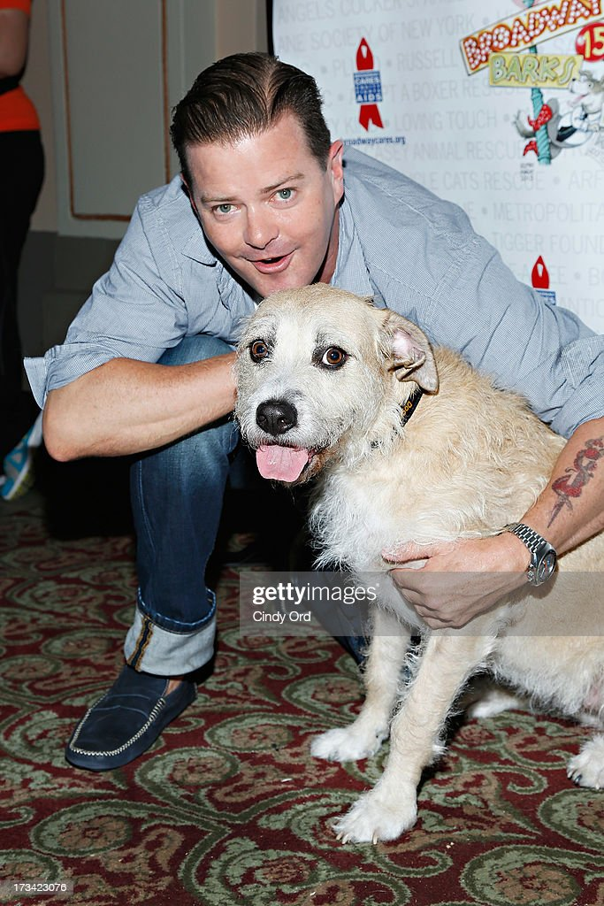 Actors Clarke Thorell and Sandy attend the Broadway Barks 15th Animal Adoption Event at Shubert Alley on July 13, 2013 in New York City.