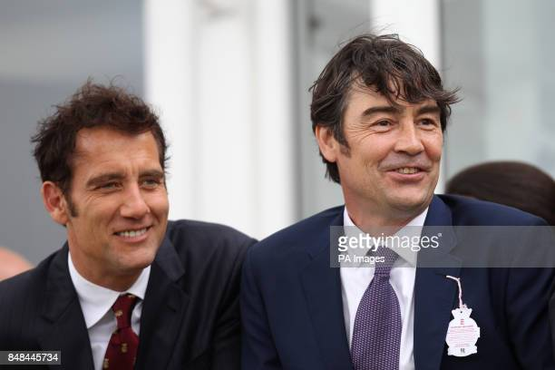 Actors Clive Owen and Nathaniel Parker watch The Artemis Goodwood Cup during Ladies Day of the Glorious Goodwood Festival at Goodwood Racecourse...