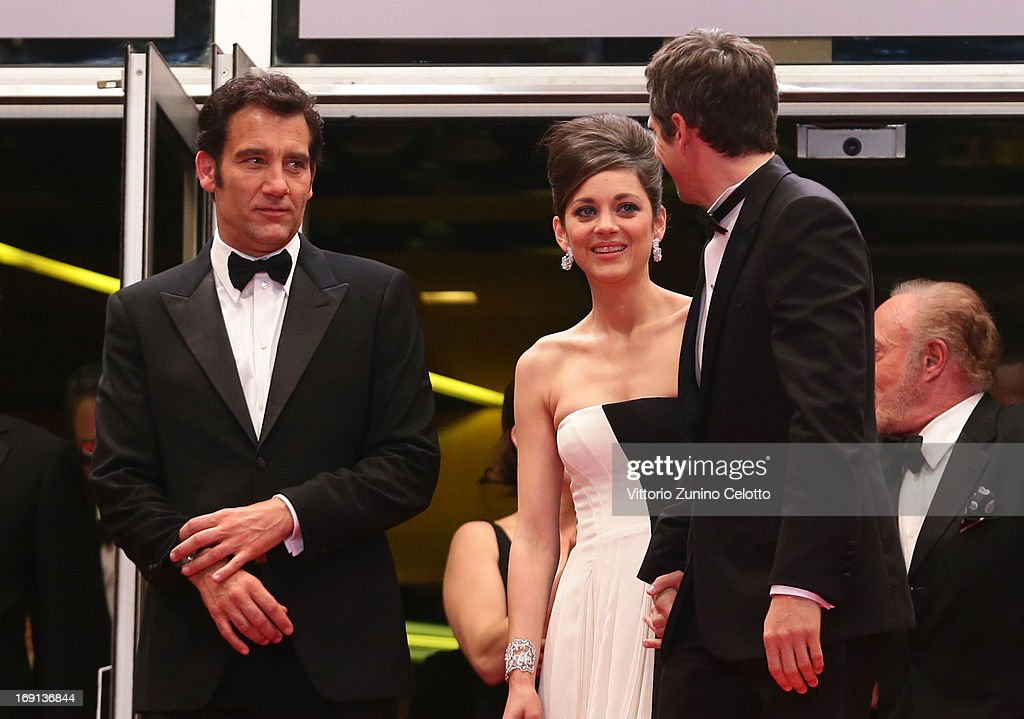 Actors Clive Owen, Marion Cotillard and director Guillaume Canet depart the 'Blood Ties' Premiere during the 66th Annual Cannes Film Festival at the Palais des Festivals on May 20, 2013 in Cannes, France.