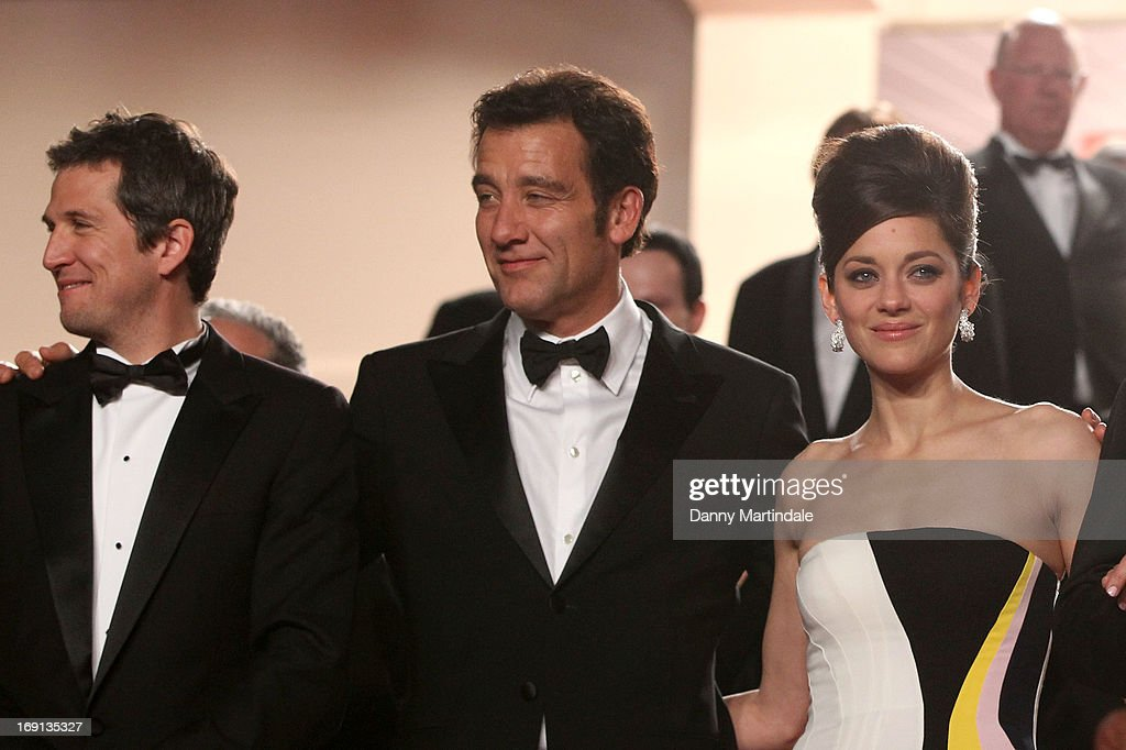 Actors <a gi-track='captionPersonalityLinkClicked' href=/galleries/search?phrase=Clive+Owen&family=editorial&specificpeople=201515 ng-click='$event.stopPropagation()'>Clive Owen</a>, <a gi-track='captionPersonalityLinkClicked' href=/galleries/search?phrase=Marion+Cotillard&family=editorial&specificpeople=215303 ng-click='$event.stopPropagation()'>Marion Cotillard</a> and <a gi-track='captionPersonalityLinkClicked' href=/galleries/search?phrase=James+Caan+-+Actor&family=editorial&specificpeople=206773 ng-click='$event.stopPropagation()'>James Caan</a> leave the Premiere of 'Blood Ties' during the 66th Annual Cannes Film Festival at the Palais des Festivals on May 20, 2013 in Cannes, France.