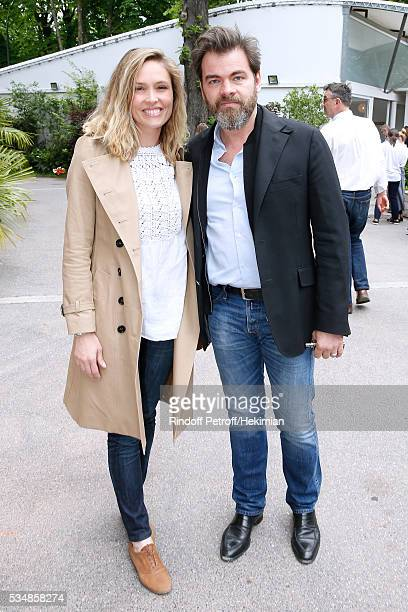 Actors Clovis Cornillac and his wife Lilou Fogli attend Day Seven of the 2016 French Tennis Open at Roland Garros on May 28 2016 in Paris France