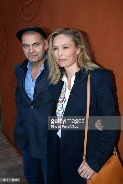 Actors Clovis Cornillac and his wife Lilou Fogli attend the 2017 French Tennis Open Day Thirteen at Roland Garros on June 9 2017 in Paris France