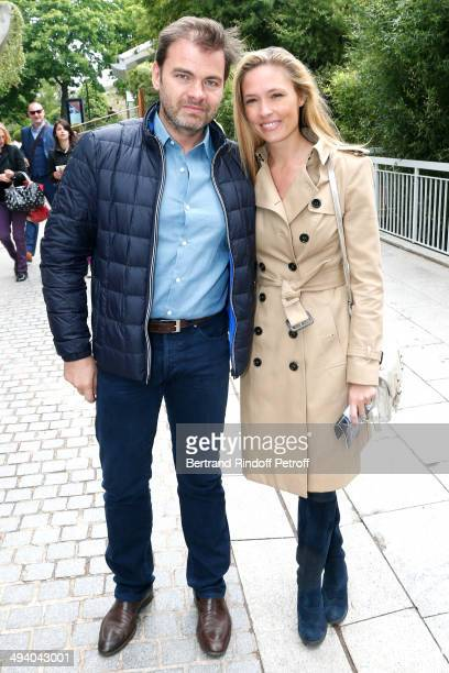 Actors Clovis Cornillac and his wife Lilou Fogli attend the Roland Garros French Tennis Open 2014 Day 3 on May 27 2014 in Paris France