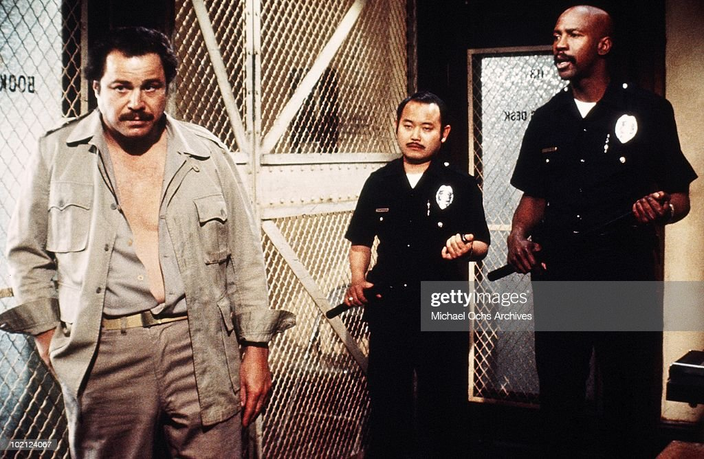 Actors Clyde Kusatsu (center) and Louis Gossett Jr. (right) in a scene from the movie 'The Quoirboys' in 1977 in Los Angeles, California.