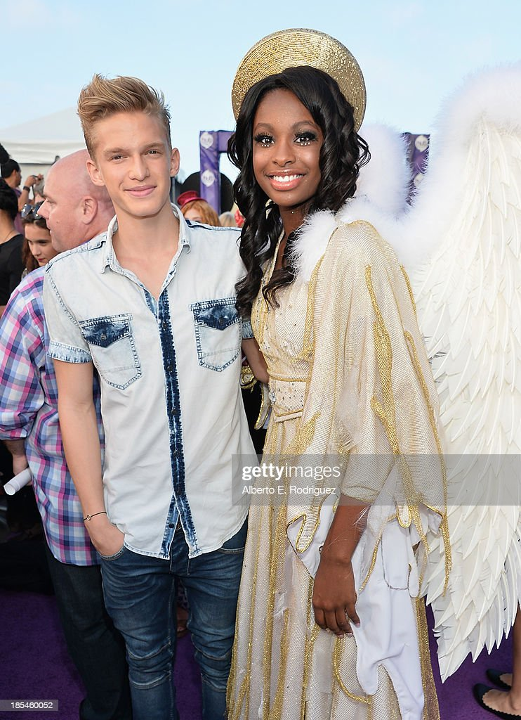 Actors Cody Simpson and Coco Jones attend the Hub Network's 1st Annual Halloween Bash at Barker Hangar on October 20, 2013 in Santa Monica, California.
