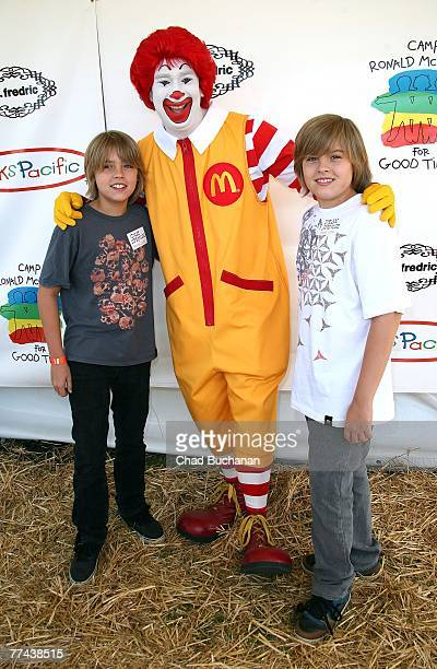 Actors Cole Sprouse and Dylan Sprouse pose with clown Ronald McDonald at the Camp Ronald McDonald 15th Annual Family Halloween Carnival on October 21...
