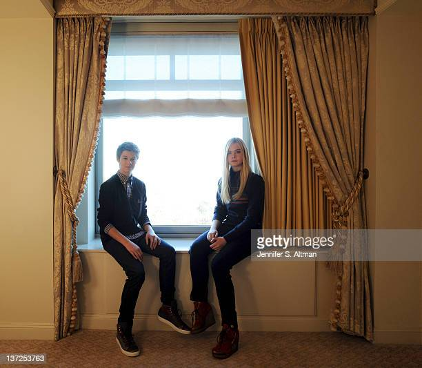Actors Colin Ford and Elle Fanning are photographed for Los Angeles Times on December 9 2011 in New York City