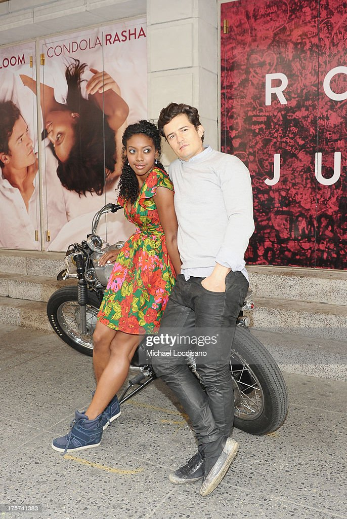 Actors Condola Rashad (L) and Orlando Bloom appear for the 'Romeo And Juliet' Broadway photo call at Richard Rodgers Theatre on August 7, 2013 in New York City.