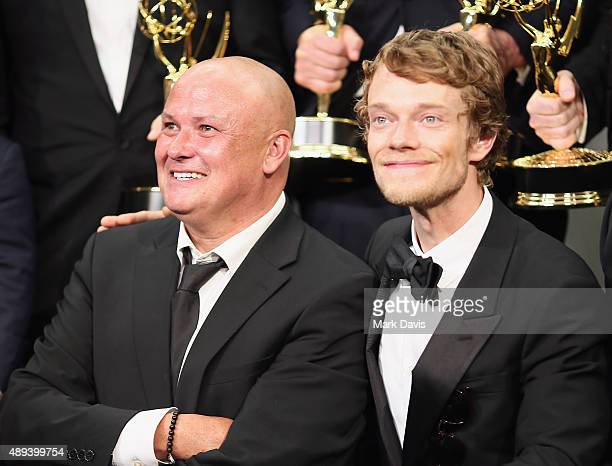 Actors Conleth Hill and Alfie Allen winners of the award for Outstanding Drama Series for 'Game of Thrones' poses in the press room at the 67th...